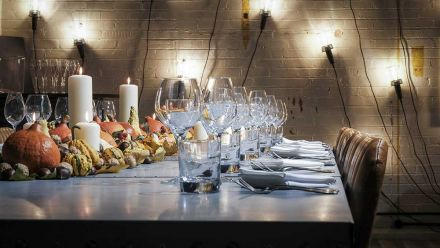 Dine at a Zinc banqueting table in a beautiful warehouse-style private dining room just feet away from an impressive commercial kitchen.